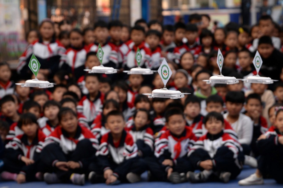 Students watch a drone performance at a primary school in Handan