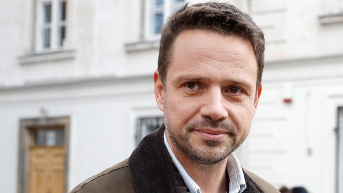 Rafal Trzaskowski, Civic Coalition candidate for mayor of Warsaw, poses outside the polling station after casting his vote during the Polish regional elections, in Warsaw