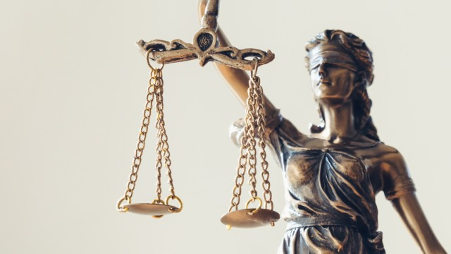 Lady Justice Statue Against White Background
