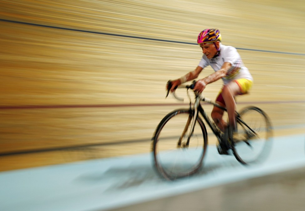 French cyclist Robert Marchand, aged 106, cycles at the indoor Velodrome National of Saint-Quentin-en-Yvelines
