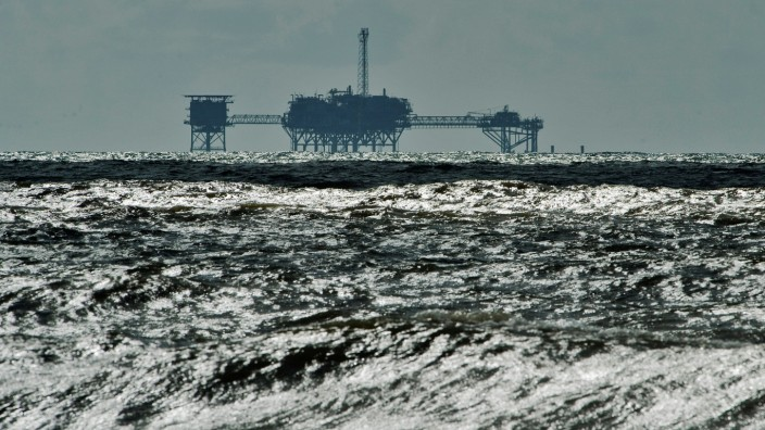FILE PHOTO: An oil and gas drilling platform stands offshore in the Gulf of Mexico in Dauphin Island Alabama