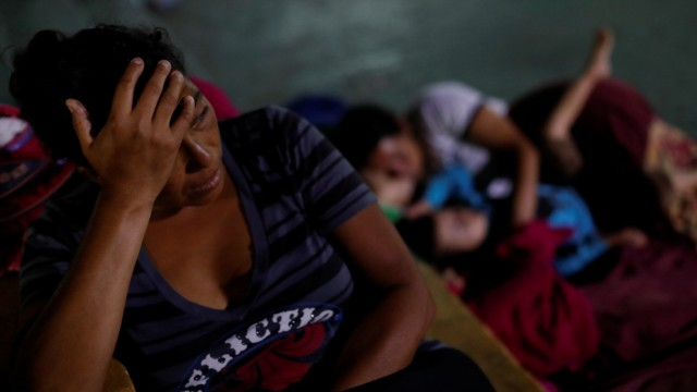 Maria Nino, migrant from Honduras and part of a caravan trying to reach the U.S., rests next to her relatives in a public square as they wait to regroup with more migrants, in Tecun Uman