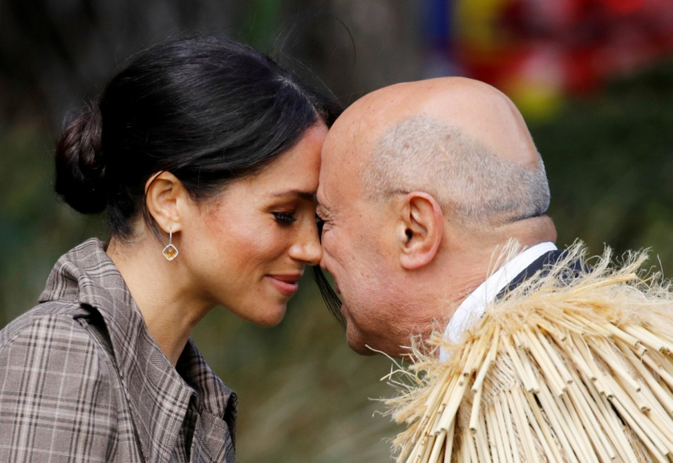 Meghan, Duchess of Sussex, exchanges a hongi during a welcome ceremony at Government House in Wellington