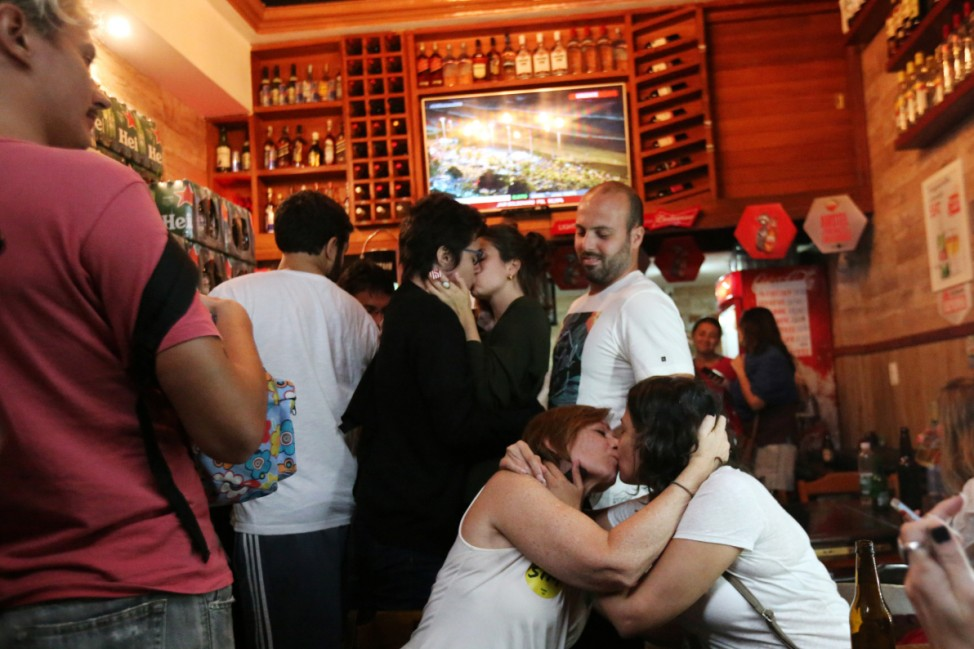 Supporters of Fernando Haddad, presidential candidate of Brazil's leftist Workers Party (PT), kiss in an act of protest against supporters of Jair Bolsonaro, far-right lawmaker and presidential candidate of the Social Liberal Party (PSL), during a runoff