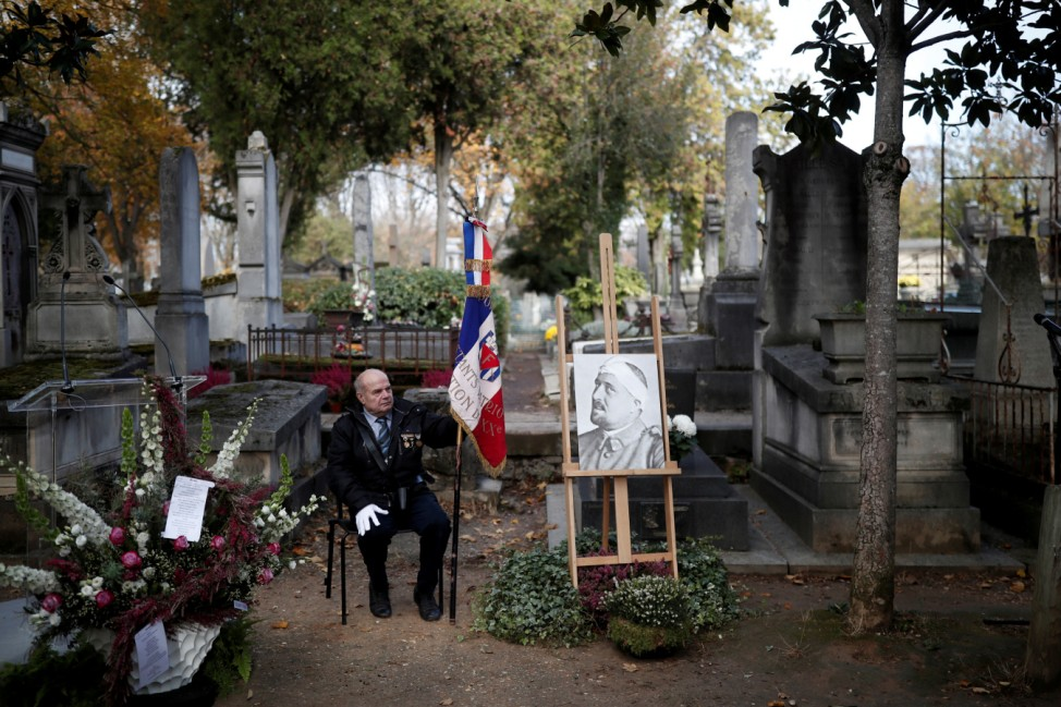 A portrait of French poet Guillaume Apollinaire is seen during a ceremony to commemorate the centenary of his death at Pere Lachaise Cemetery in Paris