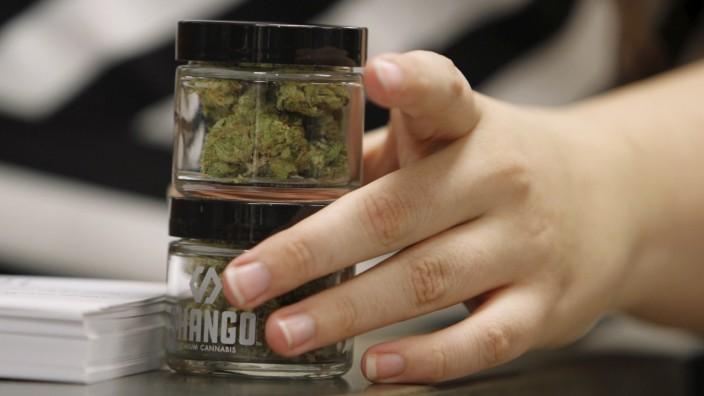 Employees at Shango Cannabis shop sell legal recreational marijuana beginning at midnight in Portland, Oregon