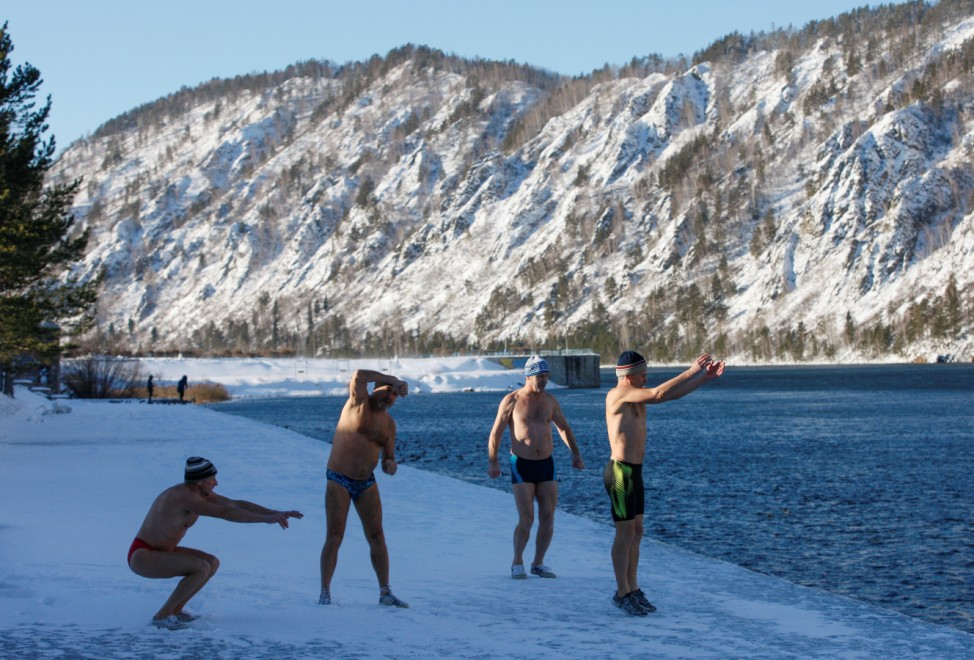 Members of a winter swimming club warm up ahead of their weekly bathing session in Divnogorsk