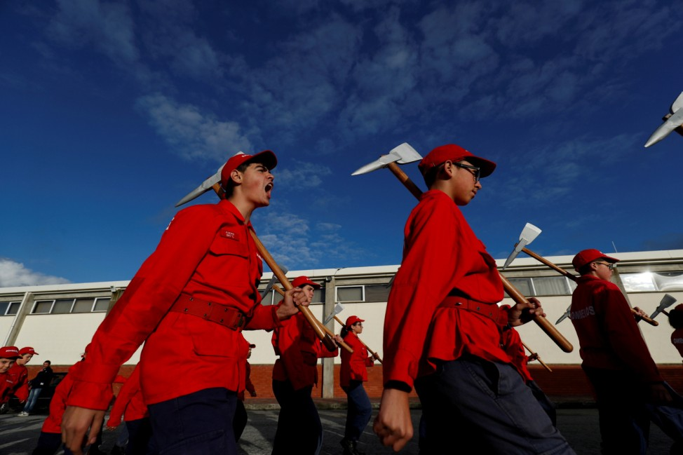 Members of firefighter school march during a training session in Oliveira do Hospital