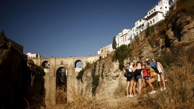 Tourists take a selfie in front of the 'Puente Nuevo' during the World Tourism Day, in Ronda