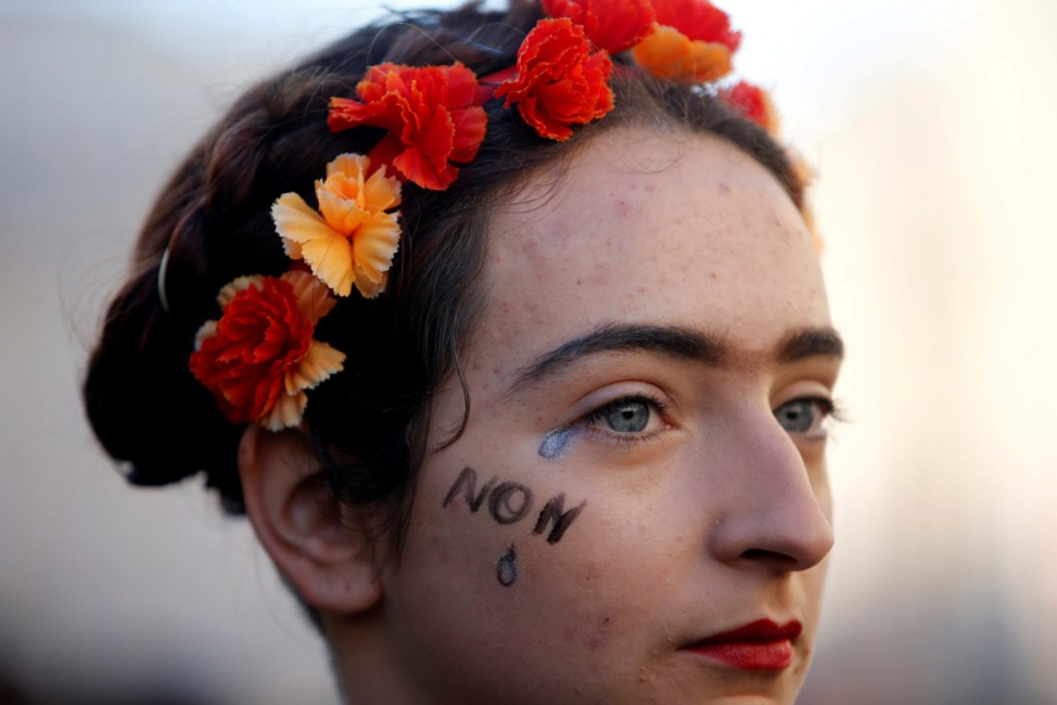 A woman attends a rally against gender-based and sexual violence against women in Marseille