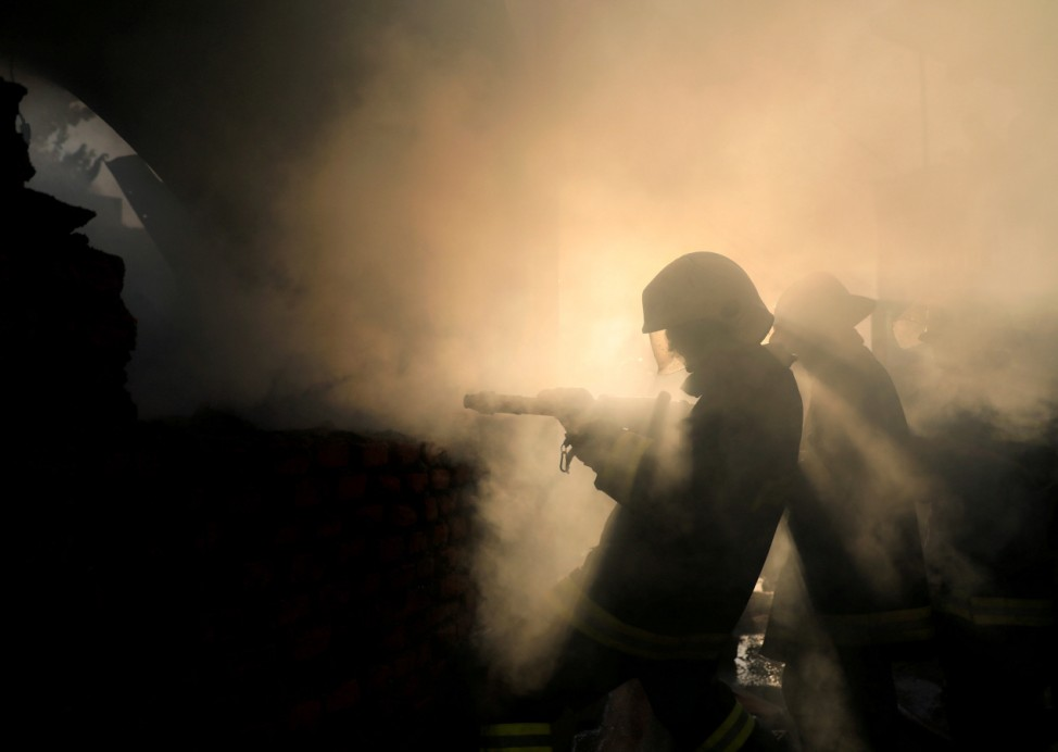 Firefighters work to put out a fire at a warehouse in Kathmandu