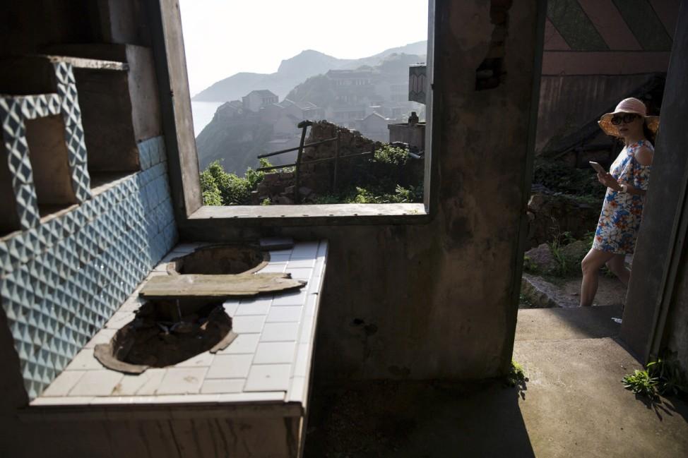 Wider Image: Creeping Vines, Abandoned Village