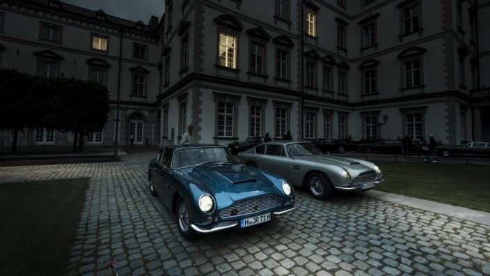Germany North Rhine Westphalia Bensberg two Aston Martin DB 6 parking in front of Bensberg Castle