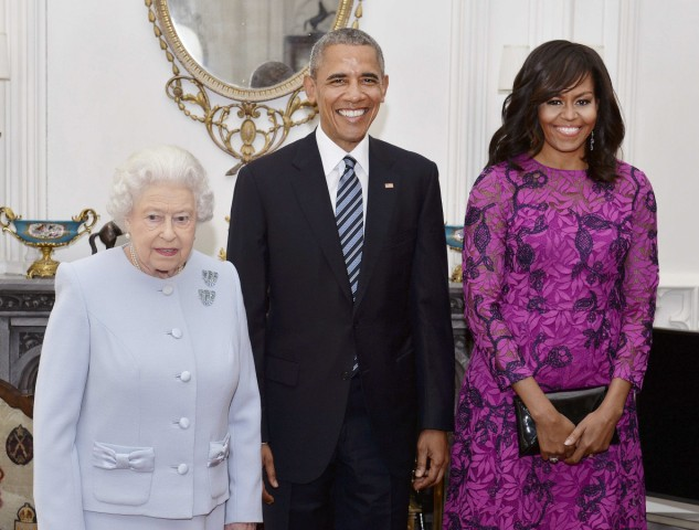 Queen Elizabeth II  (left) stands with the President and First Lady of the United States Barack Obama and his wife Michelle, in the Oak Room at Windsor Castle
