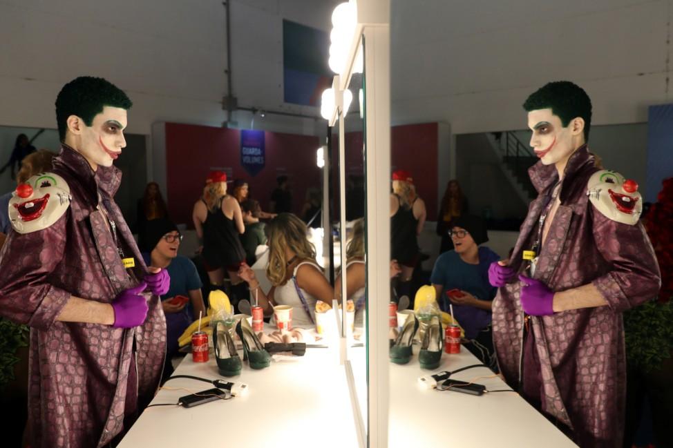 Cosplayers prepare backstage during the Sao Paulo Comic Con Experience in Sao Paulo