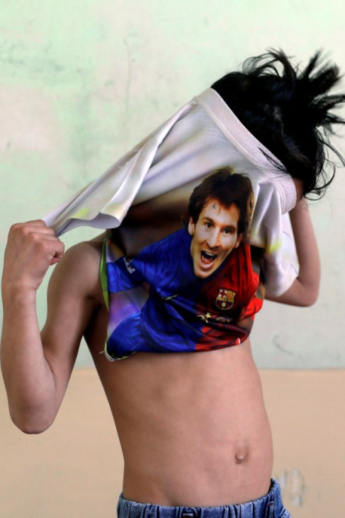 Murtaza Ahmadi, 7, an Afghan Lionel Messi fan, wears a T-shirt at his house in Kabul