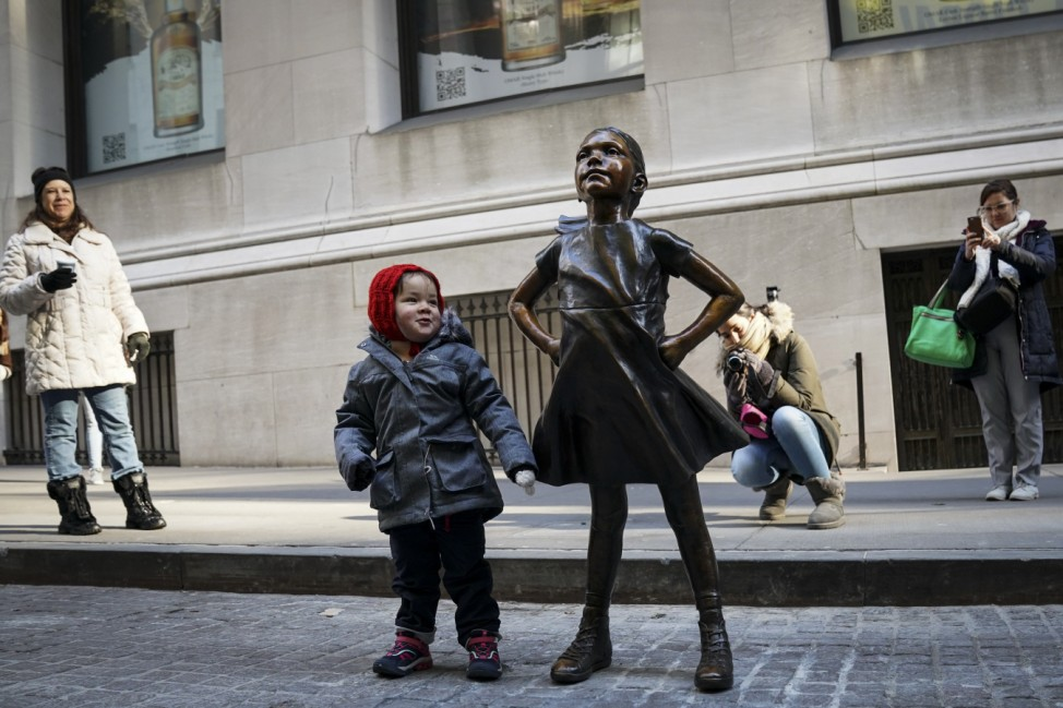 'Fearless Girl' Statue Moves To Her New Home Across From NY Stock Exchange