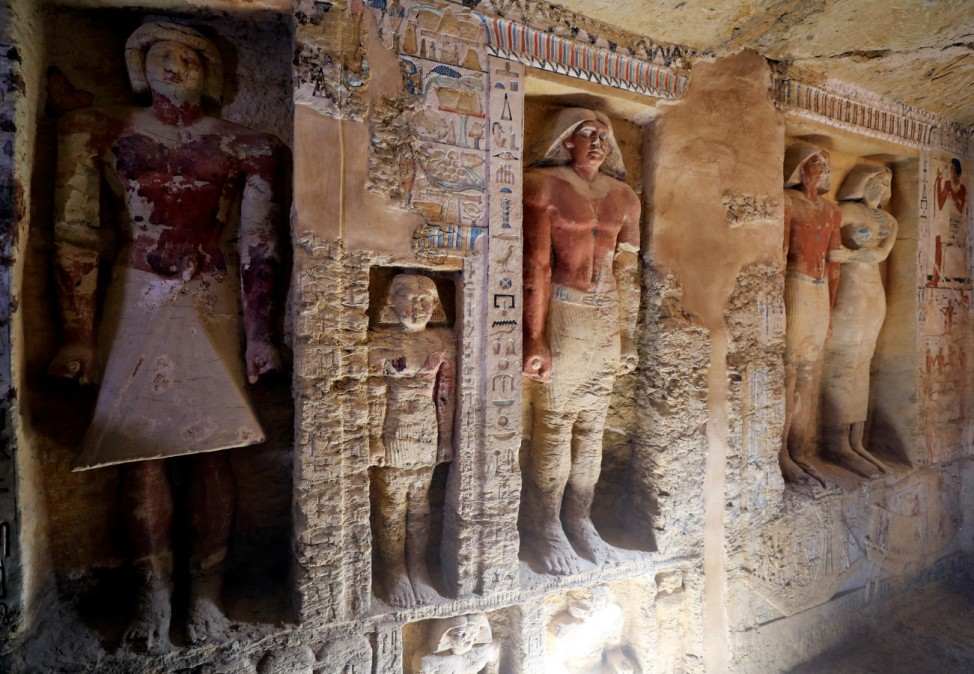 A view of statues inside the newly-discovered tomb of 'Wahtye', which dates from the rule of King Neferirkare Kakai, at the Saqqara area near its necropolis, in Giza