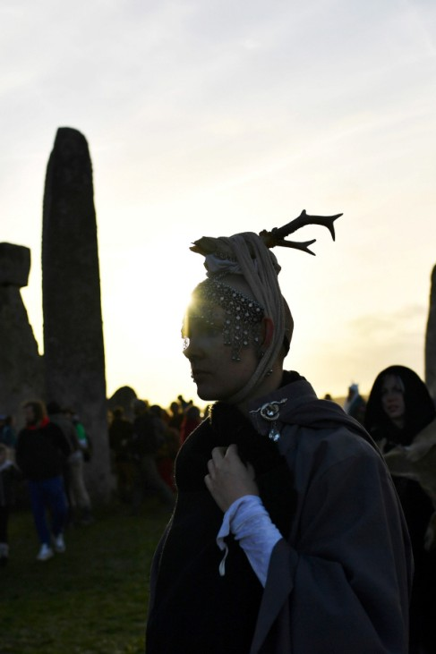 The sun rises as revellers welcome in the winter solstice at Stonehenge stone circle in Amesbury
