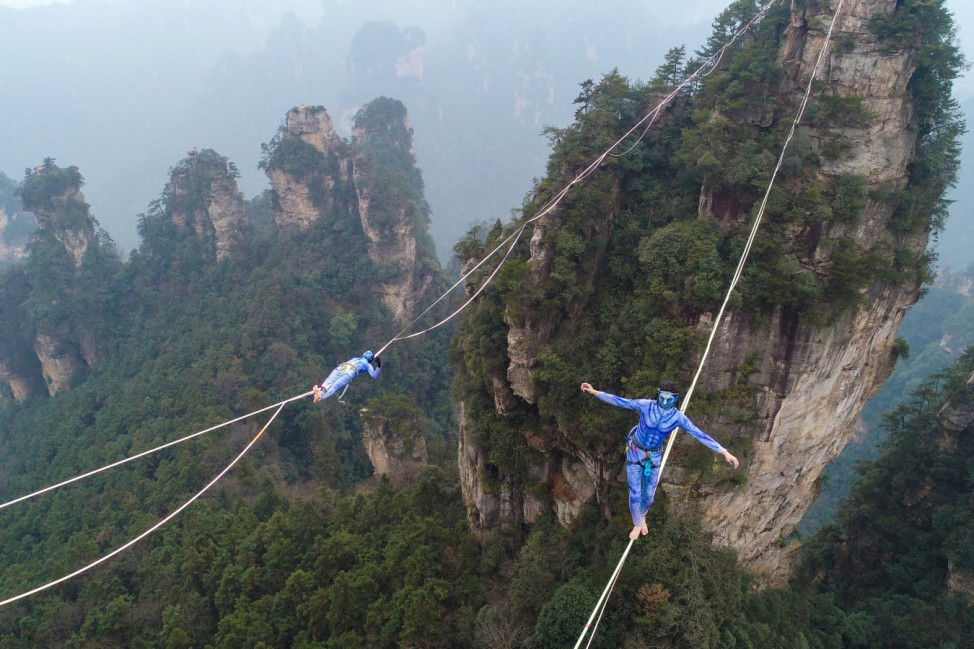 Contestants take part in a tightrope walking contest in Wulingyuan Scenic Area of Zhangjiajie