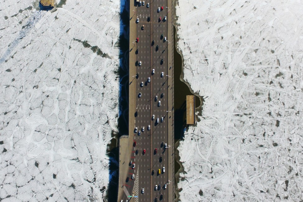 Vehicles travel on a bridge over the partially frozen Hun river in Shenyang