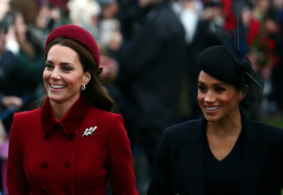 Britain's Catherine, Duchess of Cambridge and Meghan, Duchess of Sussex arrive at St Mary Magdalene's church for the Royal Family's Christmas Day service on the Sandringham estate in eastern England