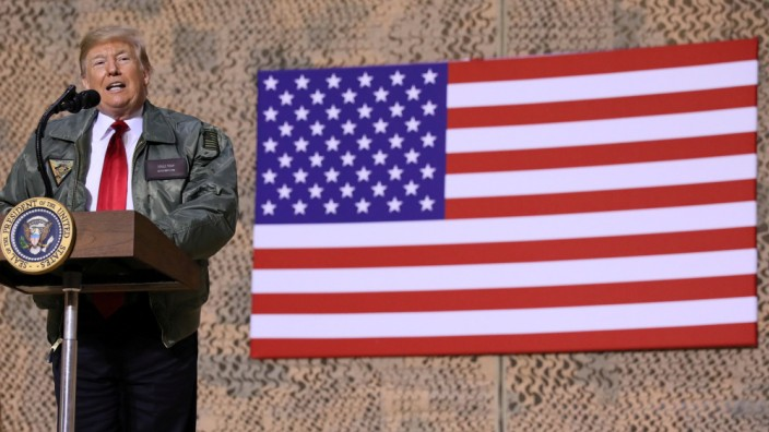 U.S. President Trump delivers remarks to U.S. troops in an unannounced visit to Al Asad Air Base, Iraq