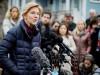 U.S. Senator Warren speaks to reporters outside her home in Cambridge