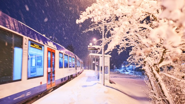 Train stop Marktoberdorf school covered in heavy onset of winter and snowfall in the morning in Mar