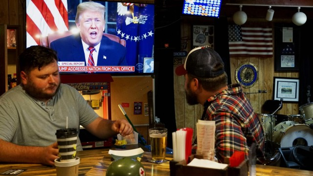 People Gather To Watch President Trump's Address On Border Security At An American Legion Post In Encinitas, California