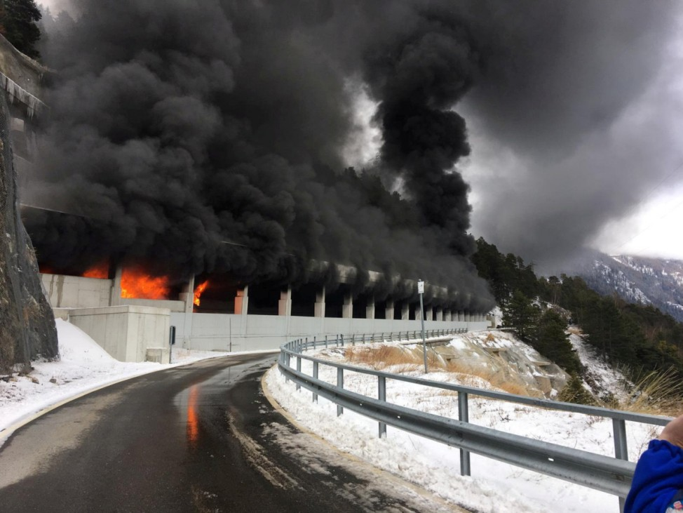 Fire and smoke are seen after a bus burnt-out in the Schallberg tunnel on the Simplon mountain pass road near Ried-Brig