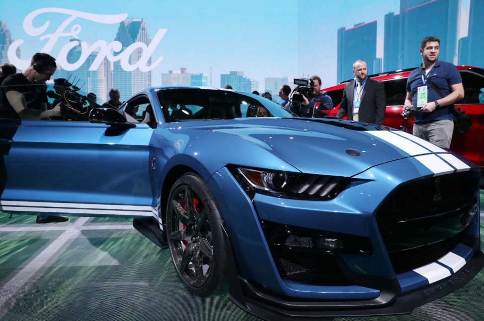 Media members with Ford Mustang Shelby GT500 at the North American International Auto Show in Detroit, Michigan