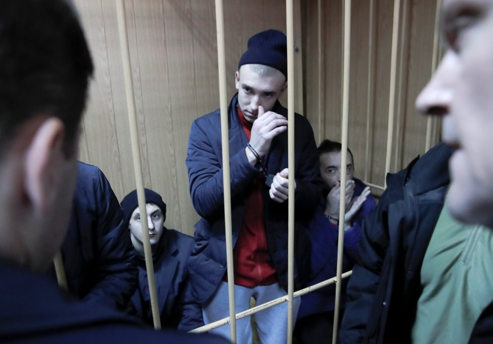 Detained crew members of Ukrainian naval ships attend a court hearing in Moscow