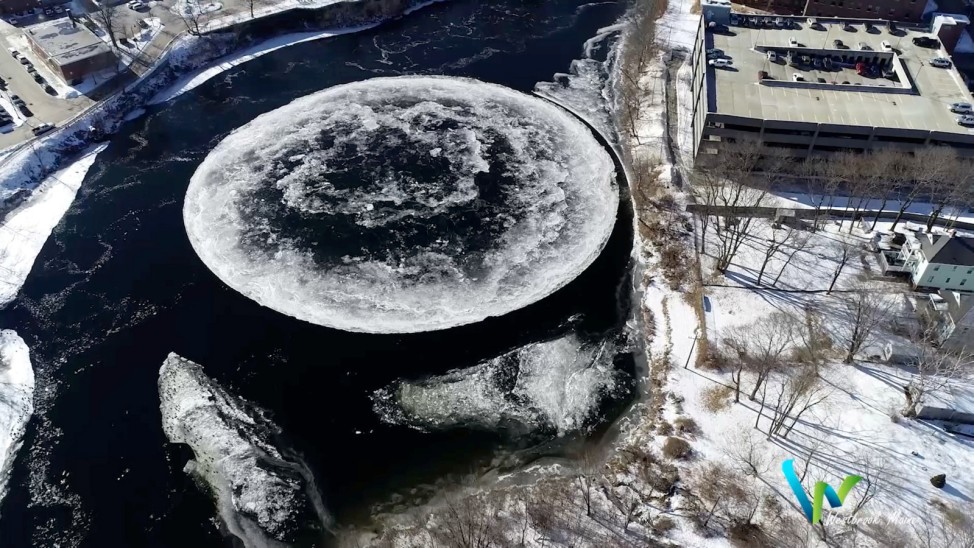 Massive ice disc formed on surface of Presumpscot River is seen in Westbrook, Maine
