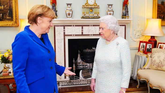 German Chancellor Angela Merkel Meets Queen Elizabeth II At Buckingham Palace