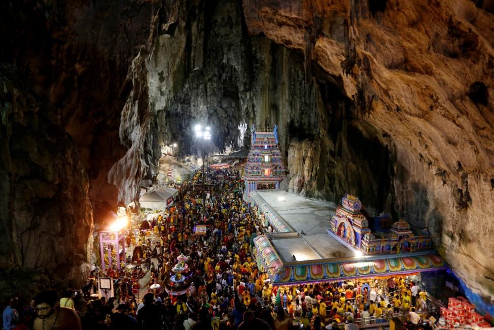 Hindu devotees gather at a shrine in Batu Caves during Thaipusam in Kuala Lumpur