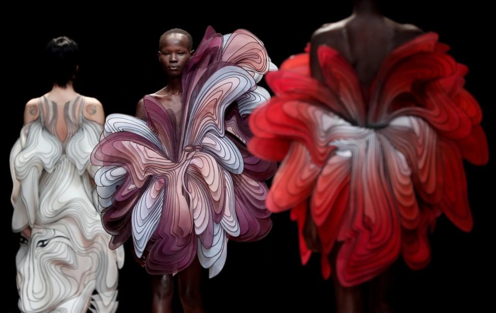 Models present creations by Dutch designer Iris van Herpen as part of her Haute Couture Spring-Summer 2019 collection show in Paris