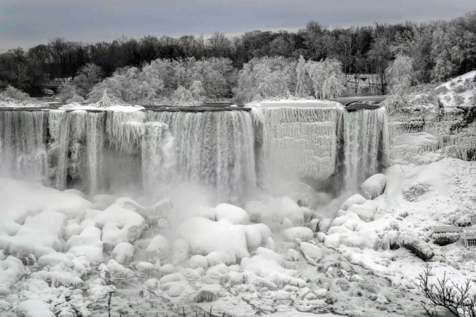 Water flows around ice in Niagara Falls