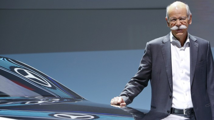 Daimler CEO Zetsche poses for pictures at the car maker's annual news conference in Stuttgart