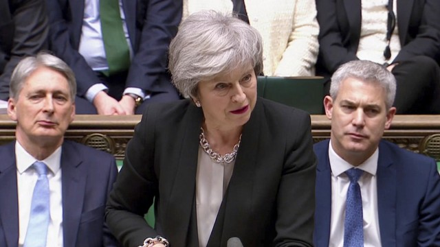 Britain's Prime Minister Theresa May speaks after the voting in Parliament, London