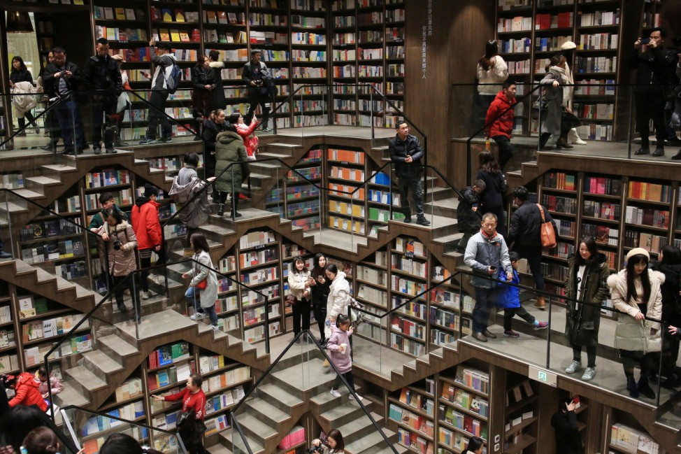 Visitors are seen inside a newly opened bookstore in Chongqing
