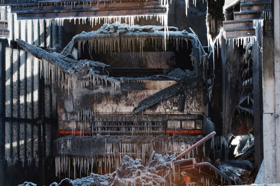 Water forms icicles on a truck are seen after a large fire was extinguished by the New York Fire Department (NYFD) during polar vortex in the Brooklyn Borough of New York