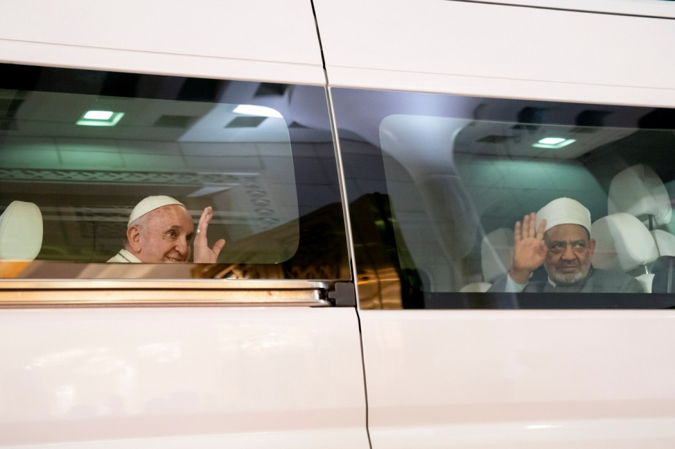 Pope Francis, Head of the Catholic Church is seen with Sheikh Ahmed Mohamed el-Tayeb, Egyptian Imam of al-Azhar Mosque, upon his arrival at Abu Dhabi International airport in Abu Dhabi