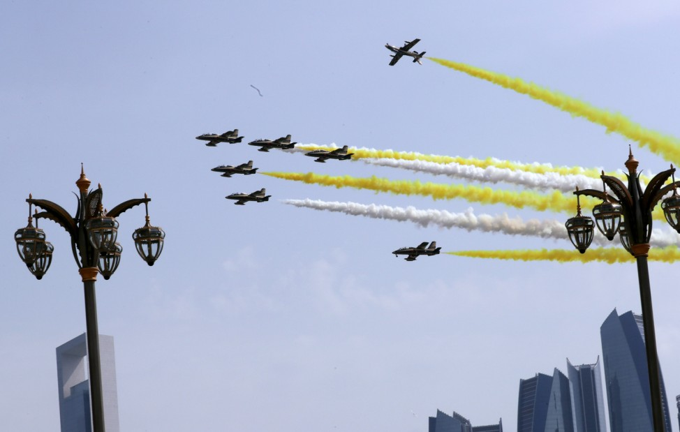 Aircrafts perform before the arrival of Pope Francis to a welcome ceremony at the Presidential Palace in Abu Dhabi