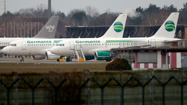 German airline Germania aircrafts are seen in parking position at Tegel airport in Berlin