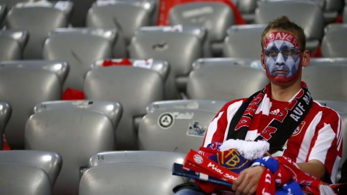 A supporter of Bayern Munich reacts as his team was defeated at penalty shootout by Chelsea during their Champions League final soccer match at the Allianz Arena in Munich