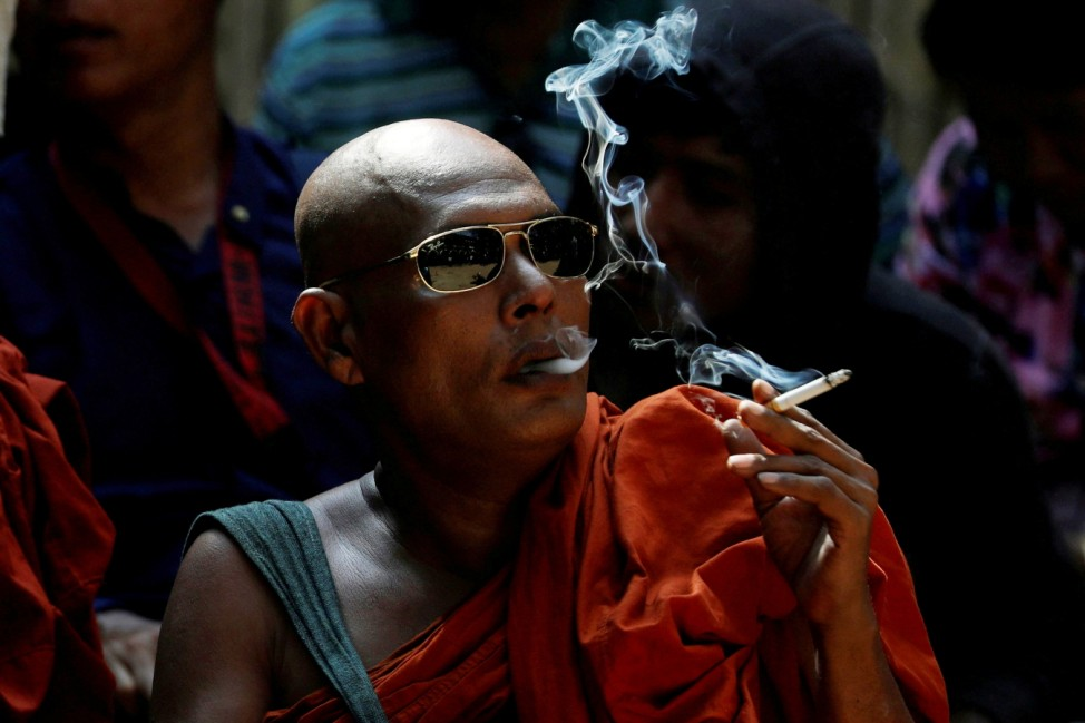 A Buddhist monk waits for the final verdict for Muslim lawyer Ko Ni's murder case at Insein court in Yangon