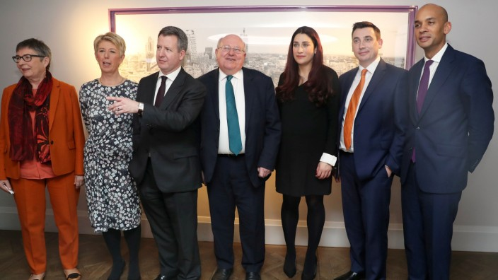 Britain's Labour Party MPs Ann Coffey, Angela Smith, Chris Leslie, Mike Gapes, Luciana Berger, Gavin Shuker and Chuka Umunna pose for a picture after their announcement they are leaving the party, in London