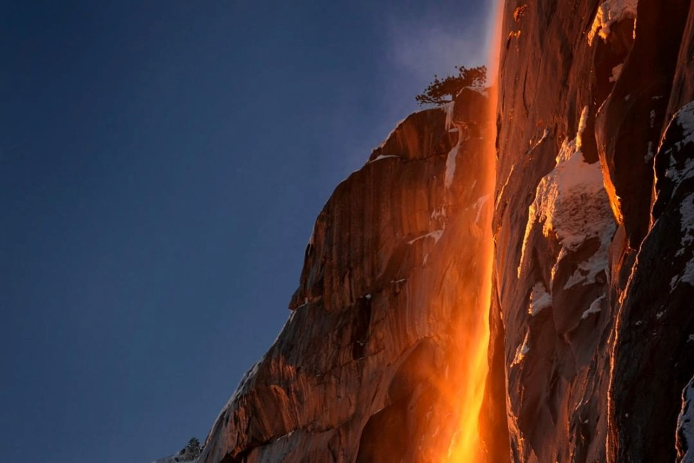 Sunlight hits the Horesetail Fall, turning it into a 'Firefall',  at Yoesemite National Park, California