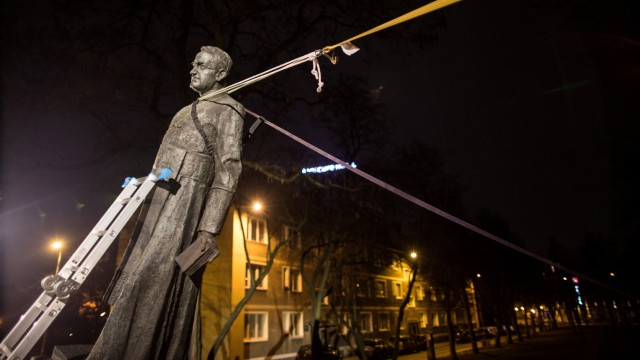 The monument of the late priest Henryk Jankowski is seen pulled down by activists in Gdansk
